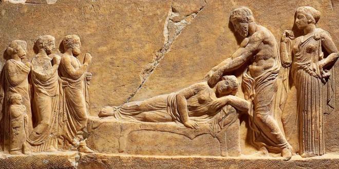 """Tavoletta votiva con scena di """"sonno incubatorio"""": la malata, distesa, è assistita dal dio Asclepio e da Igea, la sua paredra (thereef.it)"""